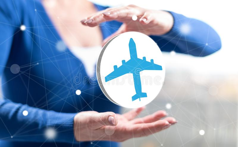 Concept of air transport. Air transport concept between hands of a woman in background royalty free stock photo