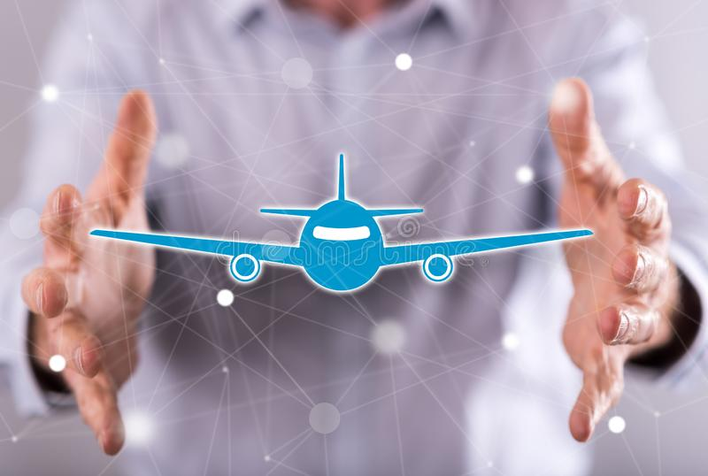 Concept of air transport. Air transport concept between hands of a man in background royalty free stock photo