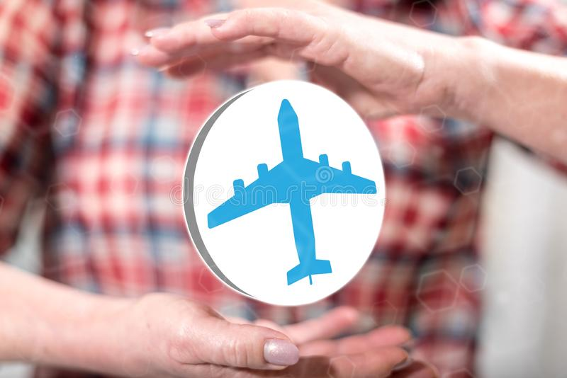Concept of air transport. Air transport concept between hands of a woman in background stock photography