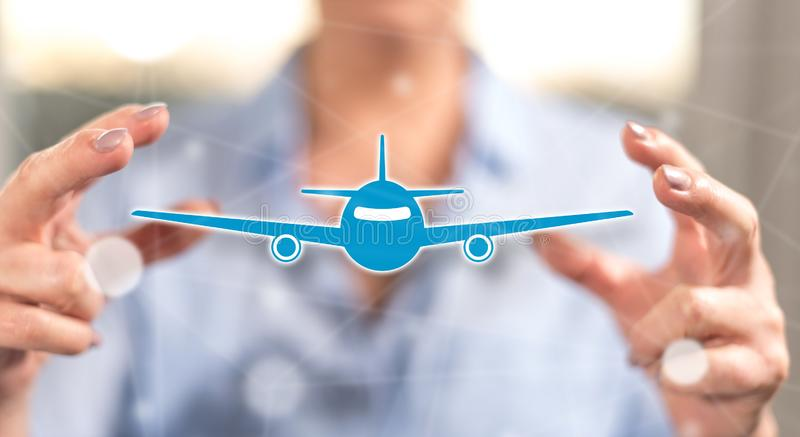 Concept of air transport. Air transport concept between hands of a woman in background stock photos