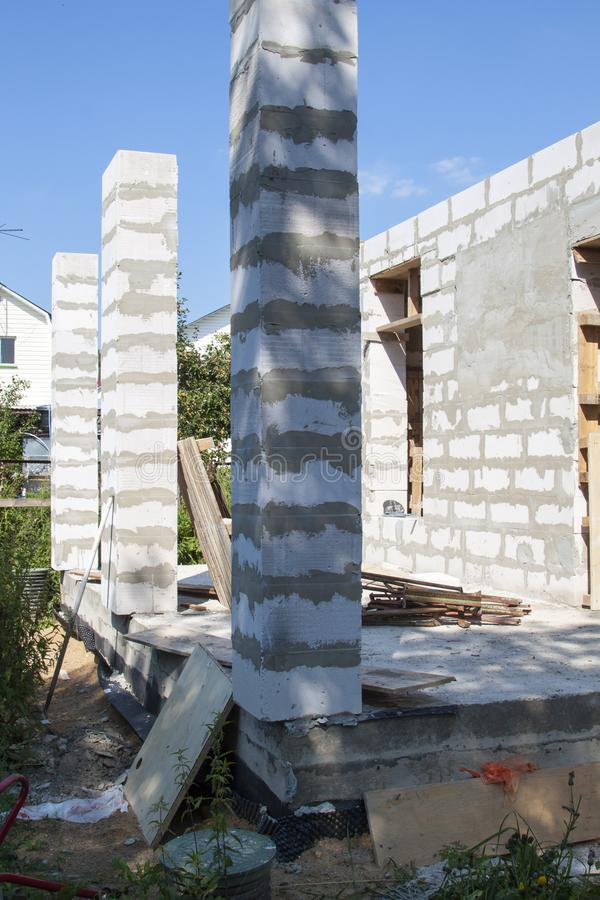 Concept of alteration of construction at customer& x27;s request. Loa. D-bearing columns made of foam block are taken out of  perimeter of foundation by 10 stock photos