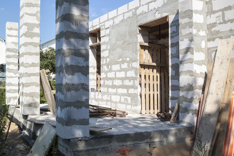 Concept of alteration of construction at customer`s request. Load-bearing columns made of foam block are taken out of  perimeter. Of foundation by 10 royalty free stock photo