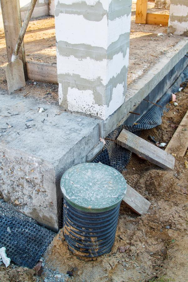 Concept of alteration of construction at customer`s request. Load-bearing columns made of foam block are taken out of  perimeter. Of foundation by 10 stock photos