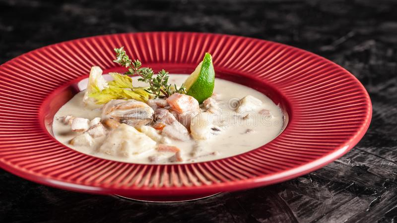 The concept of American cuisine. chowder potato soup with sea food, mussels, salmon. Fish broth soup with milk royalty free stock images
