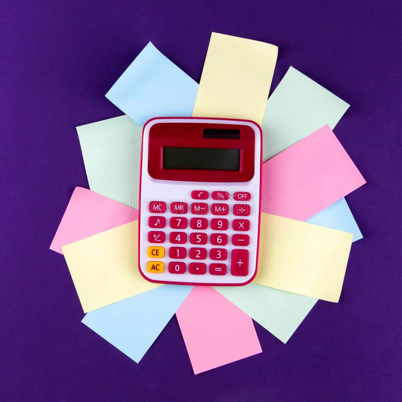 The concept of analysis, analytics, calculations. The calculator lies on colored sheets of paper stock photos