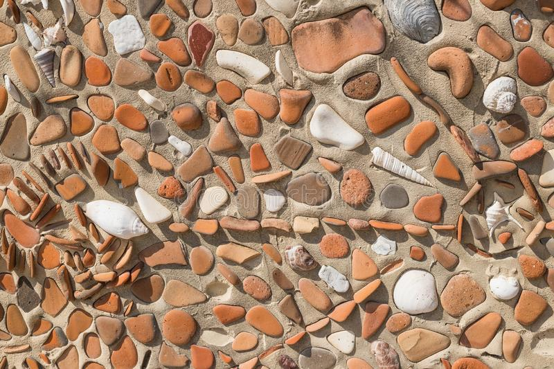 Concept of ancient culture Close up photo of broken colored stones and seashell with mosaic background .Pattern of stock image