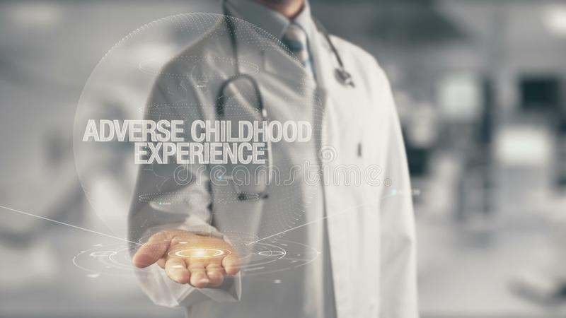 Doctor holding in hand Adverse Childhood Experience. Concept of application new technology in future medicine royalty free stock images