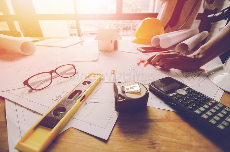 Concept architects, equipment architects On the desk with a blueprint in the office, Vintage, Sunset light stock image