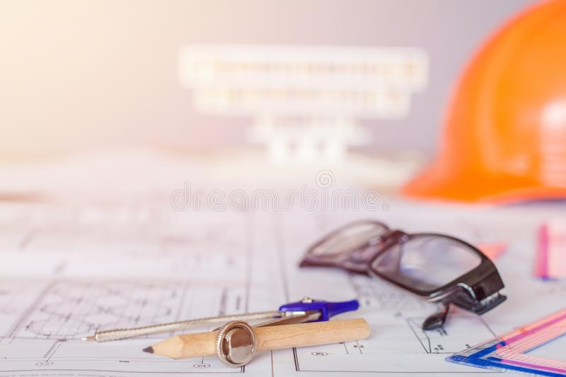 Concept architects, equipment architects On the desk with a blueprint in the office, Vintage, Sunset light. Selective Focus royalty free stock photo