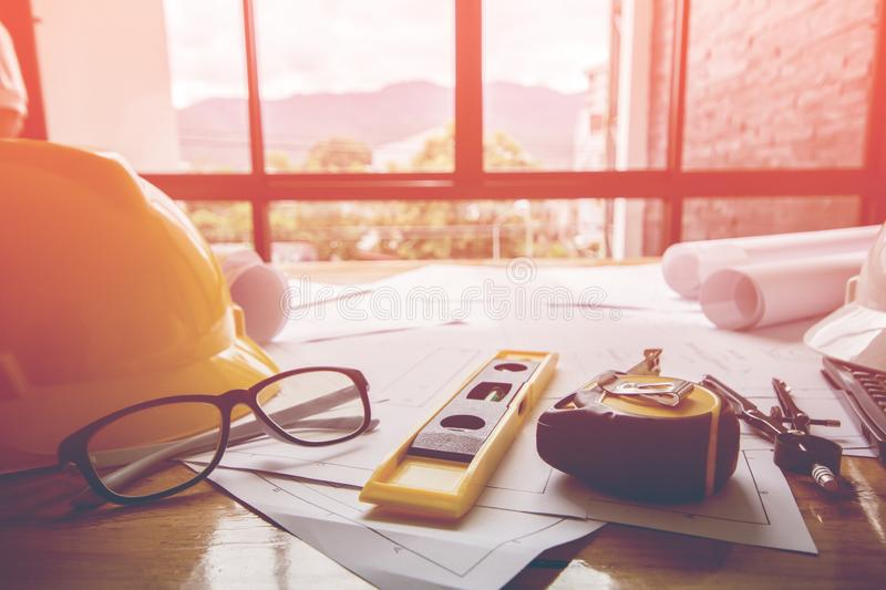 Concept architects, equipment architects On the desk with a blueprint in the office, Vintage, Sunset ligth. stock photography
