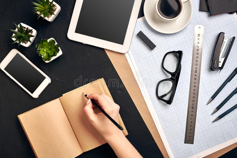 Concept architects. Architects workplace, architectural project, blueprints, ruler. Engineer holds a pen and writes in a. Notebook. Equipment architects on the royalty free stock images
