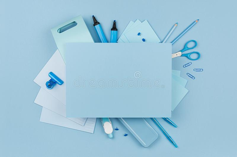 Concept art workplace for designers - blue color office accessories and blank letterhead for text on soft light blue background. Concept art workplace for royalty free stock image