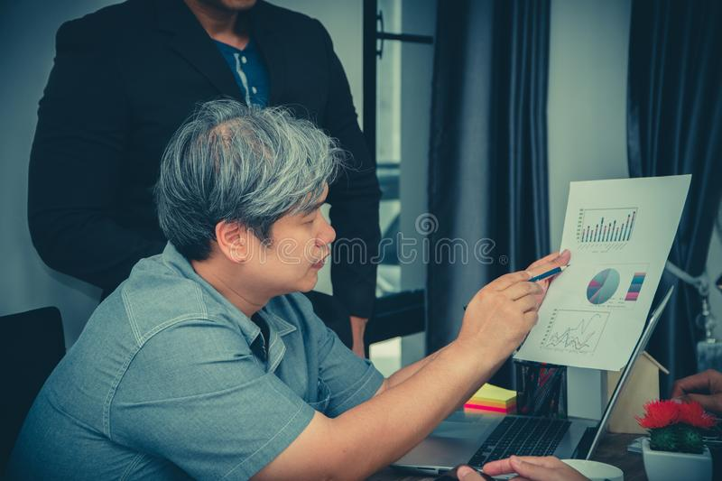 Concept of Asian startup diversity teamwork meeting.Teamwork process in co-working office. Annual sales meeting With a graph showi stock photo