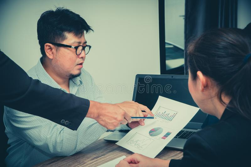 Concept of Asian startup diversity teamwork meeting.Teamwork process in co-working office. Annual sales meeting With a graph showi royalty free stock photo