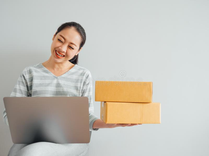 Concept of woman happy with her online business sale. Concept of Asian woman happy with her online business sale stock images