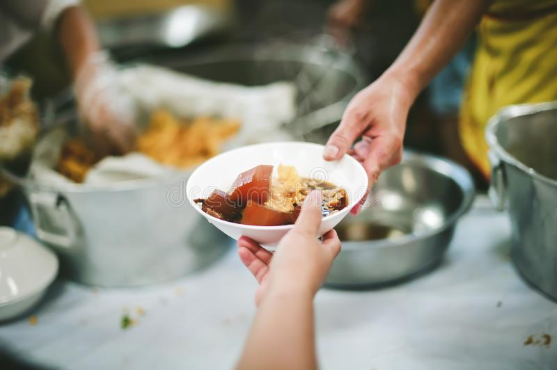 The concept of asking for food with hunger: poor people receive food donated by people in society royalty free stock photos