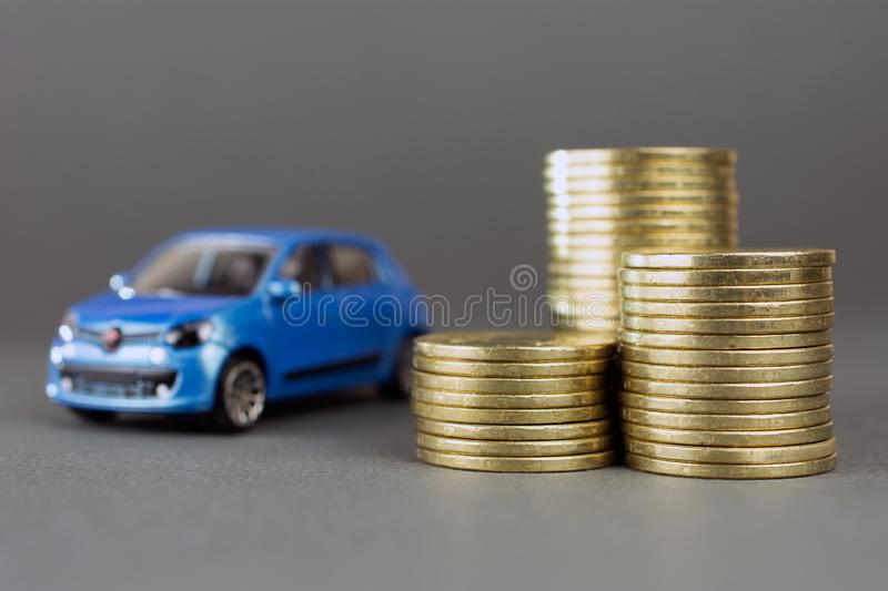 Toy car stack of coins stock photos