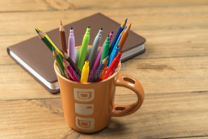 Cup full of markers and colored pencils. Concept of back to school. Cup full of markers and colored pencils royalty free stock photography