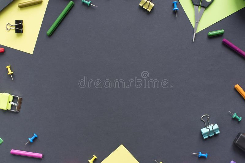 Concept back to school watch chalk line cookies stationery on black background. Top view Flat lay royalty free stock images
