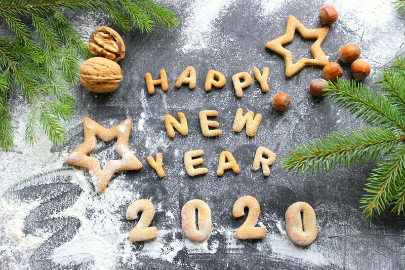 The concept 2020. Baked letters Happy New year and numbers 2020.Greeting card with gingerbread stock photography