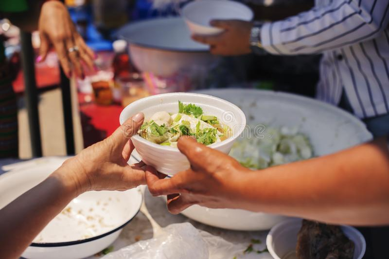 The concept of begging and hunger : Hunger problems of the poor have been donated food to reduce hunger : the concept of food. Shortage in the world : Donate royalty free stock photo