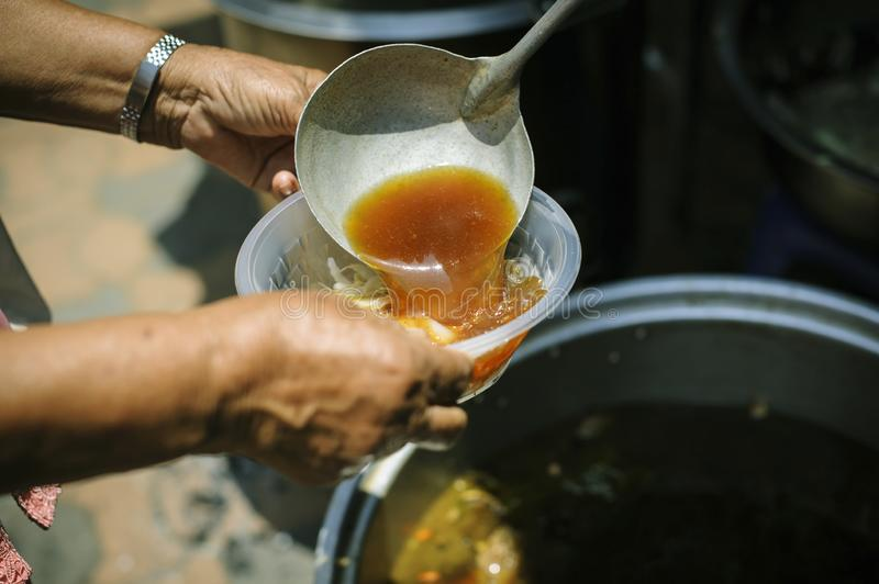 The concept of begging and hunger : Hunger problems of the poor have been donated food to reduce hunger : the concept of food. Shortage in the world : Donate stock photos