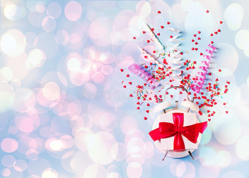 Concept of birthday, valentine and party time on blue pastel bakground with alarm and decoration royalty free stock image