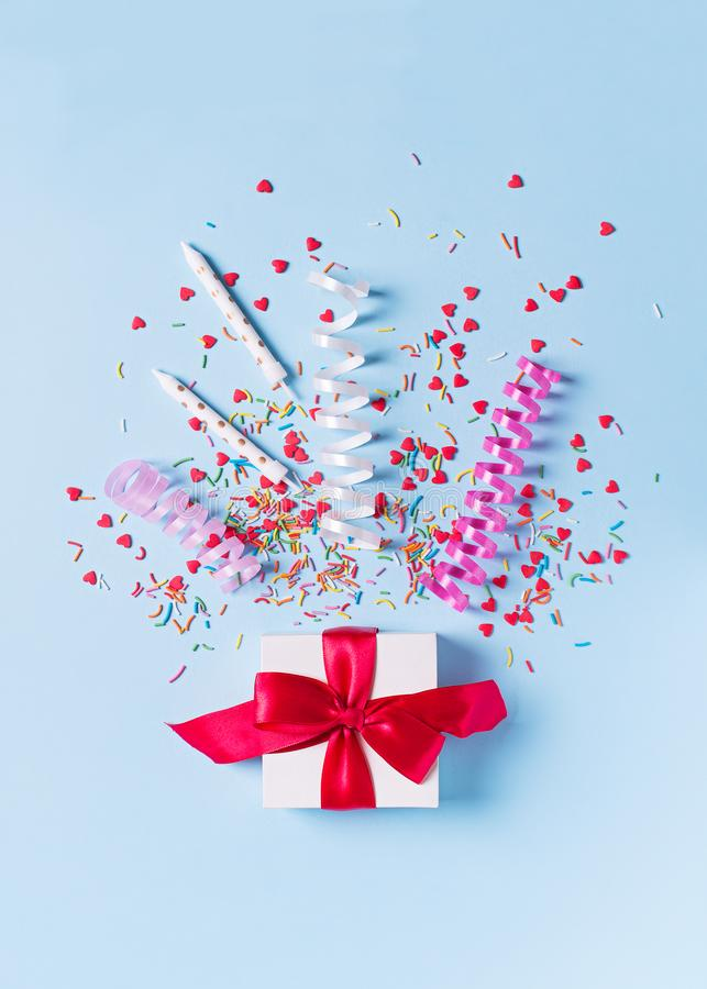 Concept of birthday, valentine and party time on blue pastel bakground with alarm royalty free stock photography