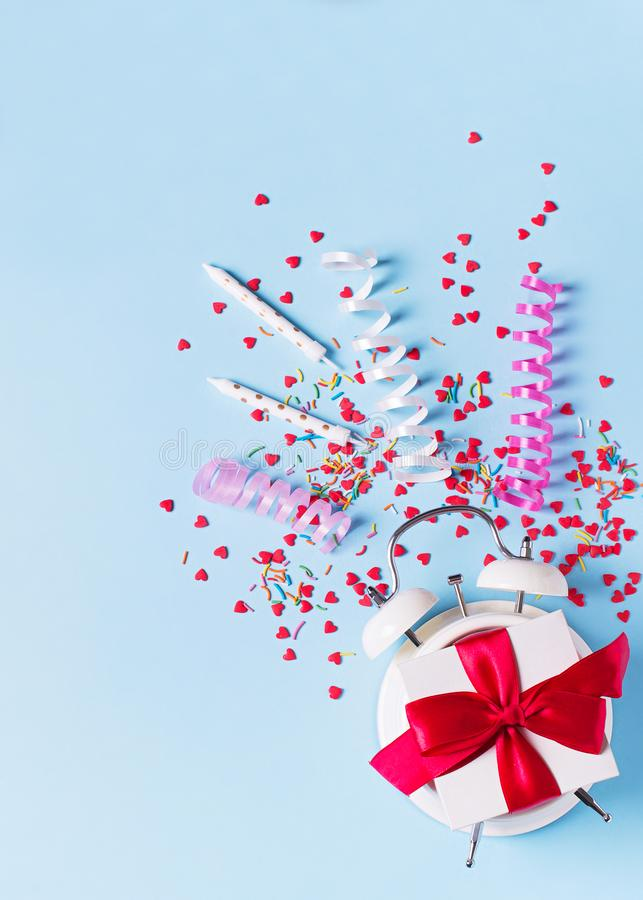 Concept of birthday, valentine and party time on blue pastel bakground with alarm royalty free stock image