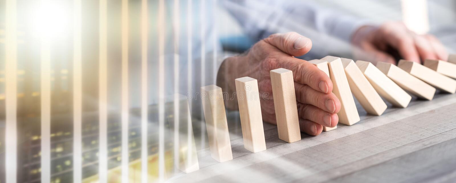 Concept of business control by stopping domino effect; multiple stock photography