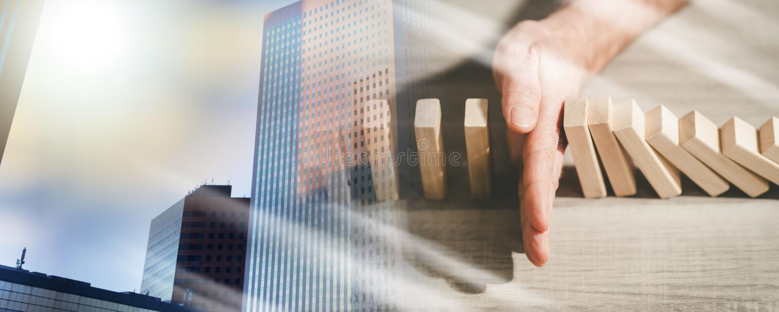 Concept of business control by stopping domino effect; multiple exposure royalty free stock photography