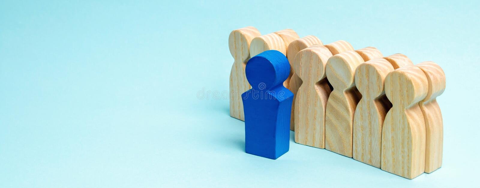 The concept of a business leader. The boss standing in front of the team and gives instructions and points to goals and business. Strategy. Business planning stock photo