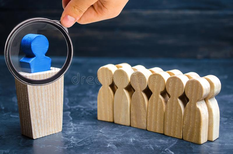 The concept of a business leader. The boss standing in front of. The team and gives instructions and points to goals and business strategy. Business planning royalty free stock photos