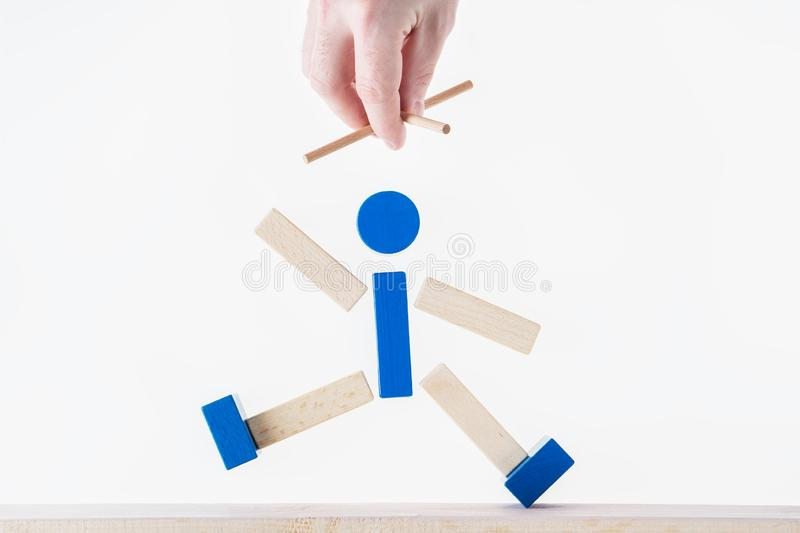 The concept of business manipulating, control of people, hypnosis. Abstract man marionette controlled hand stock images