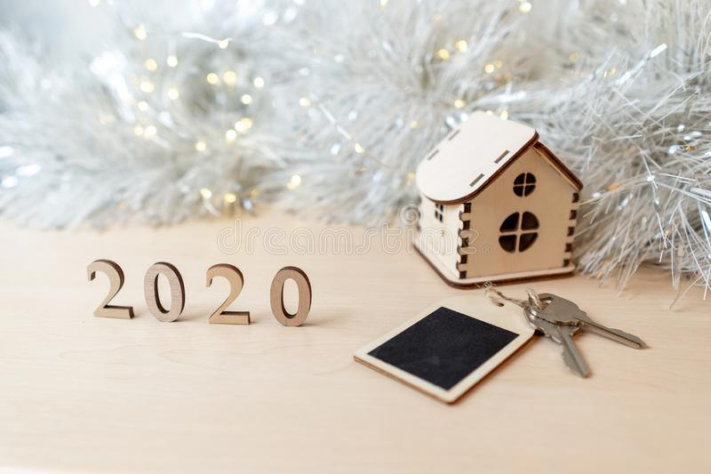 Concept for business, new year, real estate, property, rental, hotel business, building. 2020 happy new year wood number royalty free stock photography