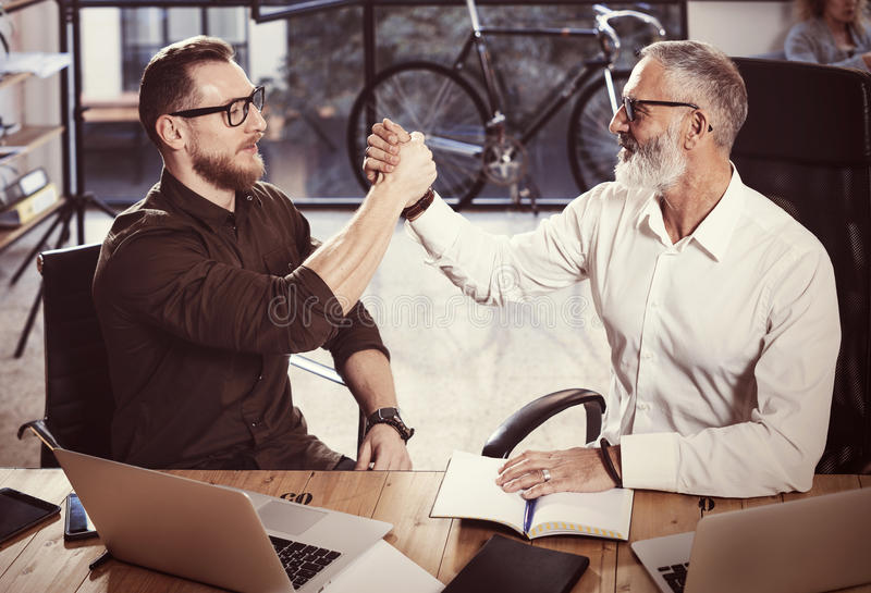 Concept of business partnership handshake.Photo two businessman handshaking process.Successful deal after great meeting royalty free stock image