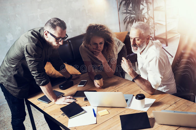 Concept of business people brainstorming.Bearded man talking with account director and creative manager to finding great. Concept of business people stock image