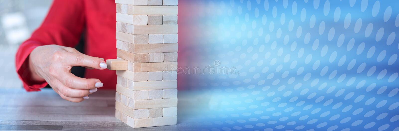 Concept of business risk. panoramic banner. Concept of business risk with domino blocks. panoramic banner royalty free stock photo