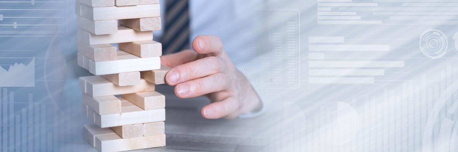 Concept of business risk; panoramic banner. Concept of business risk with domino blocks; panoramic banner royalty free stock photos