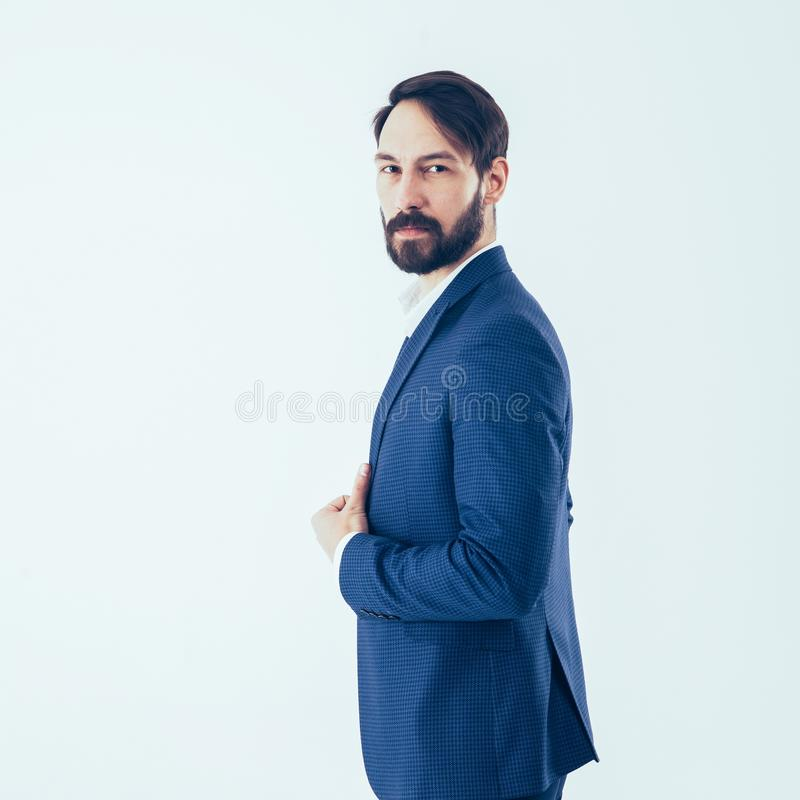 Concept of business success - a portrait in profile of a confide. Side view - a confident businessman in a business suit.the photo has a empty space for your stock photography