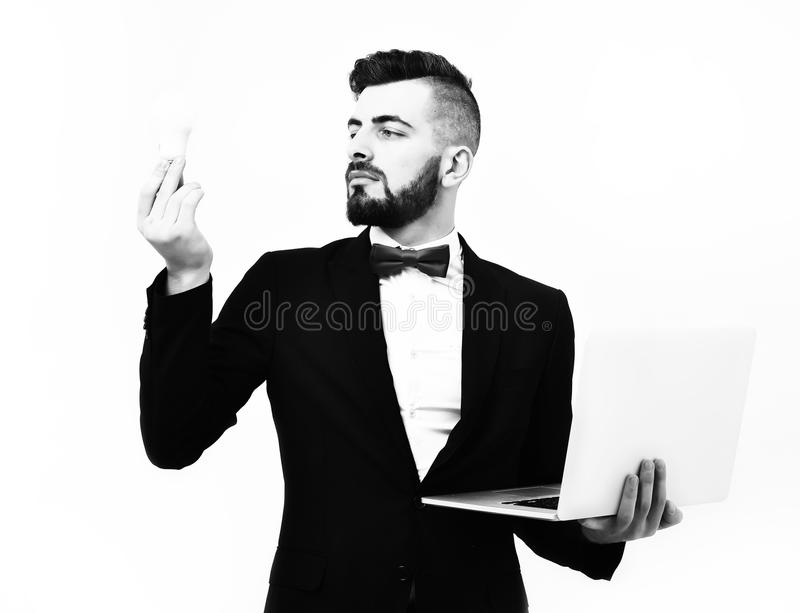 Concept of business and successful idea. Insurance agent or bearded businessman with red bow tie. And serious face holds light bulb and laptop, isolated on royalty free stock photo