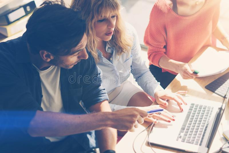 Concept of business team at working process.Young professionals work with new market project. Project managers meeting. Blurred background.Horizontal.Flares stock photos