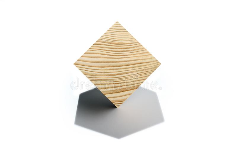 Concept of bussines balancing. Wooden cube on corner. Abstract geometric real wooden cube isolated on white background with real shadow and it`s not 3D render stock image