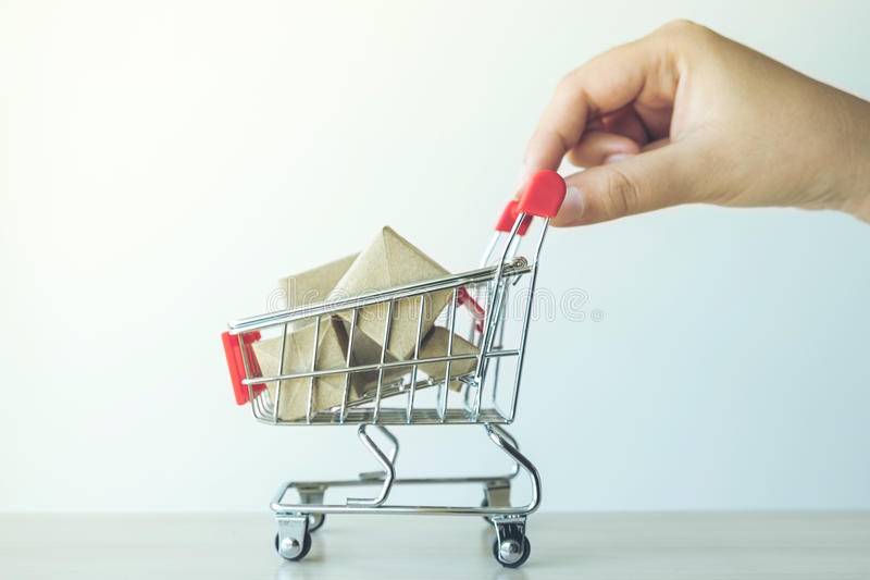 concept of buy shopping, hand of woman pushing Red shopping cart royalty free stock photo