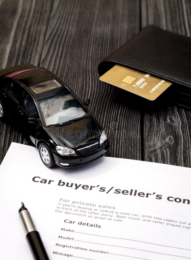 Concept of buying car on dark wooden background. Close up royalty free stock photo