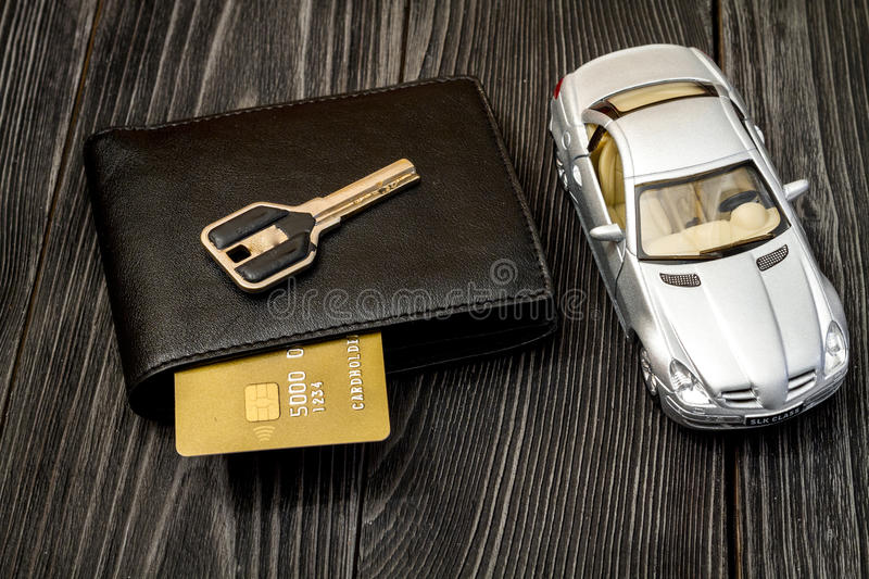 Concept of buying car on dark wooden background. Close up royalty free stock image