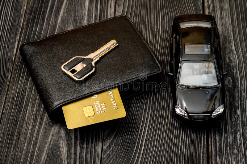Concept of buying car on dark wooden background. Close up royalty free stock photos