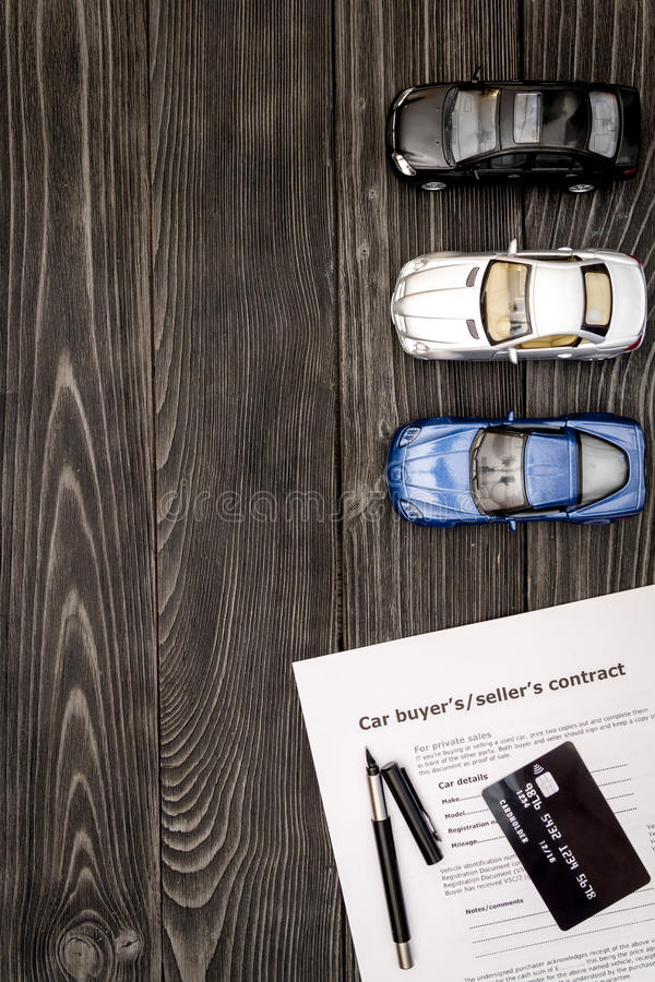 Concept of buying car on dark wooden background top view.  stock images