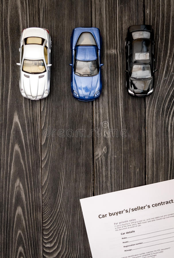 Concept of buying car on dark wooden background top view.  royalty free stock photography