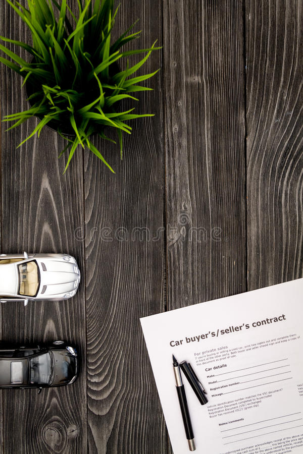 Concept of buying car on dark wooden background top view.  royalty free stock image